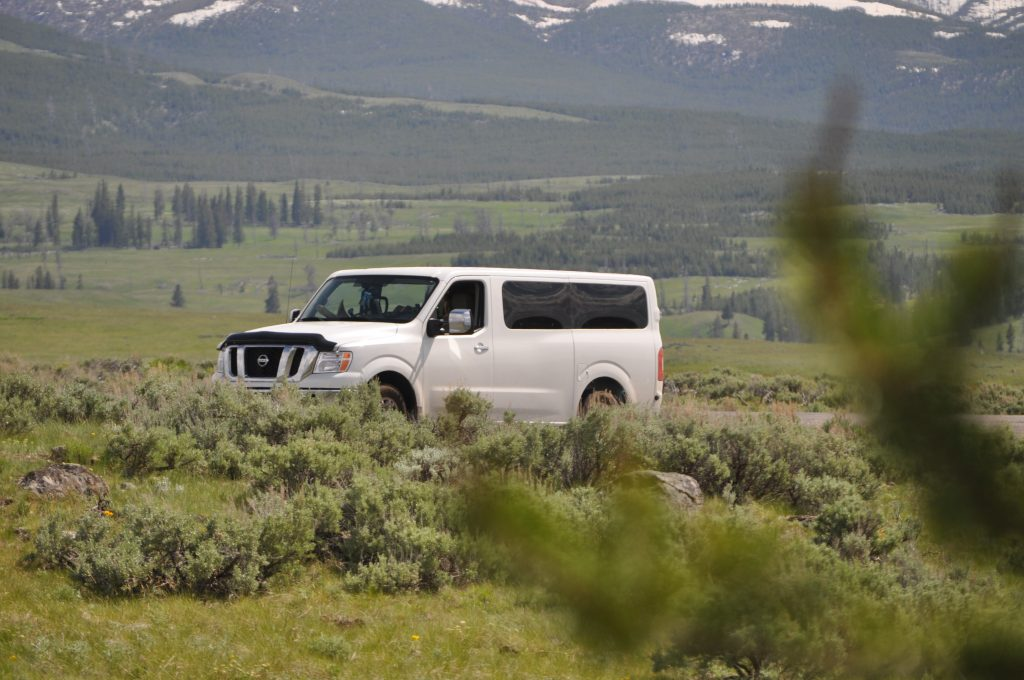 The KempBus parked at a trailhead in Yellowstone National Park
