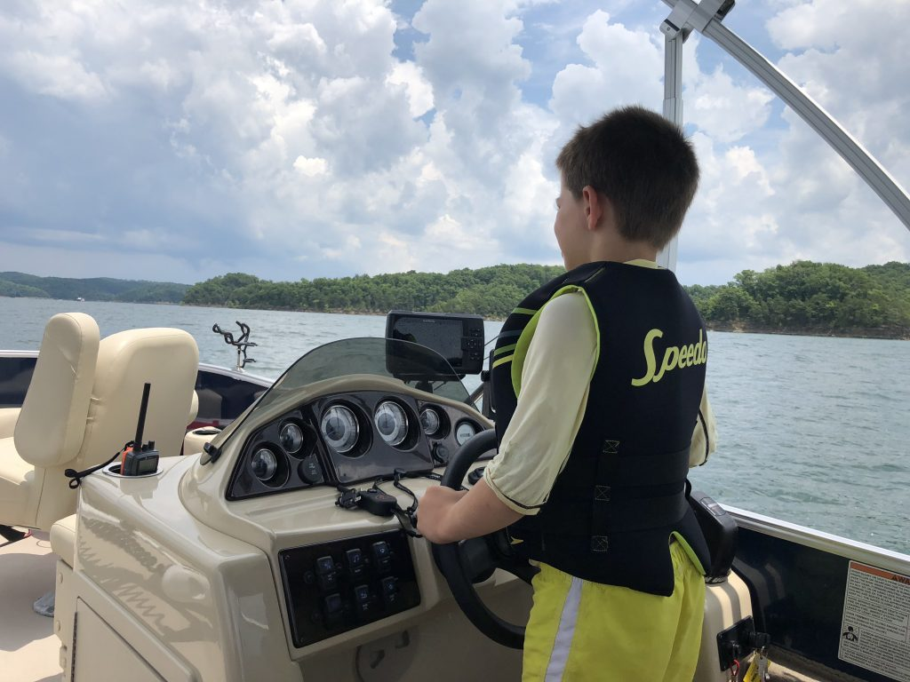 What kid doesn't love to drive the boat?
